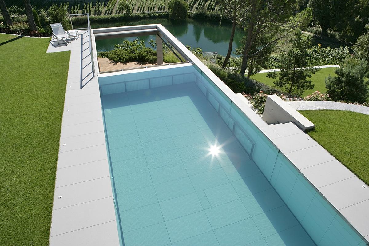 piscine à fond mobile Carré Bleu - Nicollier Piscines